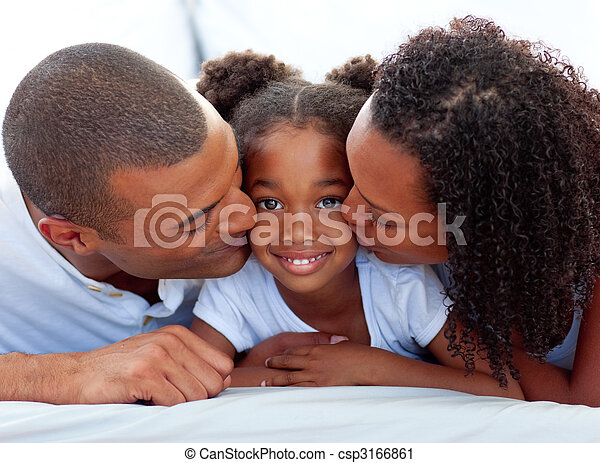 Loving parents kissing their daughter - csp3166861