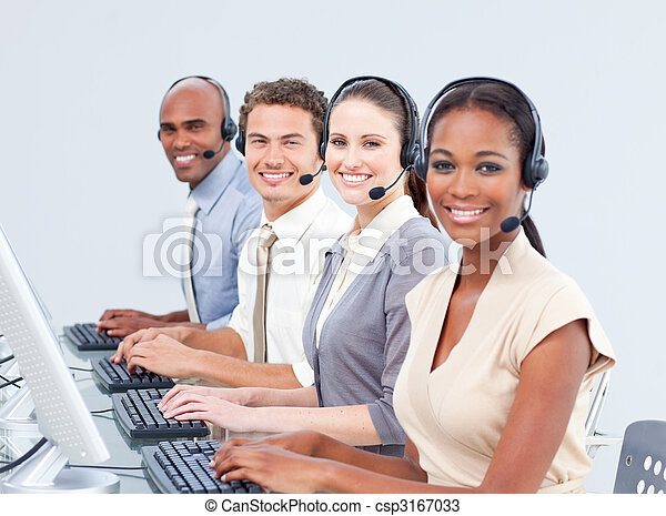 Multi-ethnic customer service representatives using headset - csp3167033