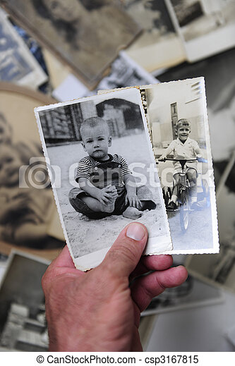 childhood: man holding photo of himself as a boy - csp3167815