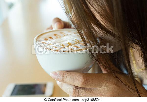 beautiful girl drinking hot coffee