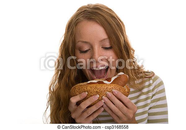 girl eating hot dog - csp3168558