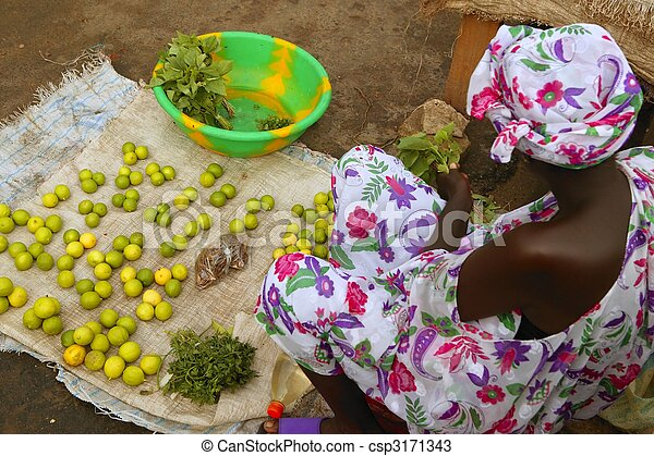 African market lemon limes and woman
