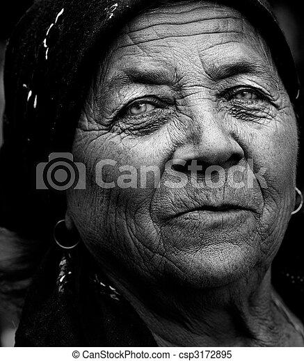 Dark artistic portrait of expressive senior woman - csp3172895