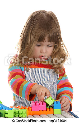 girl playing colorful building toy blocks - csp3174984