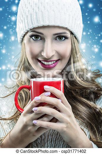 Christmas snowfall - woman holding a red mug