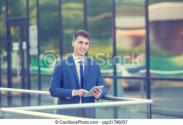 Portrait of a young businessman standing over blurred background  - csp31786057
