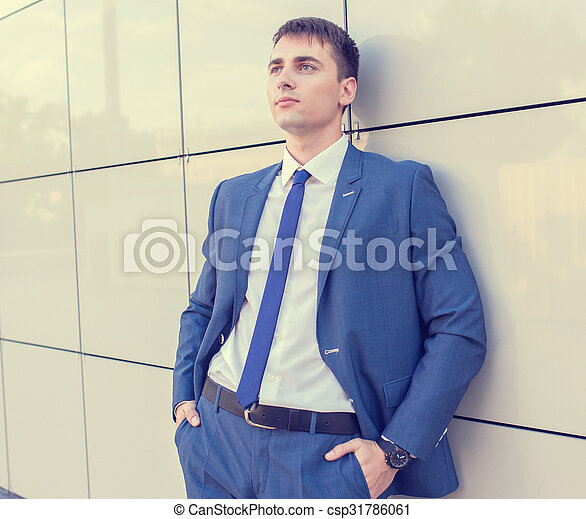 Portrait of a young businessman standing over blurred background  - csp31786061