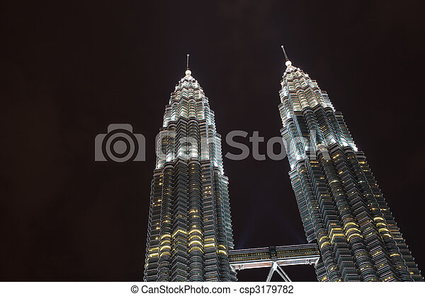 Lighted Petronas Towers Silhouetted Against Black Sky - csp3179782