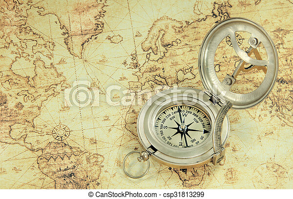 a compass on a old world map