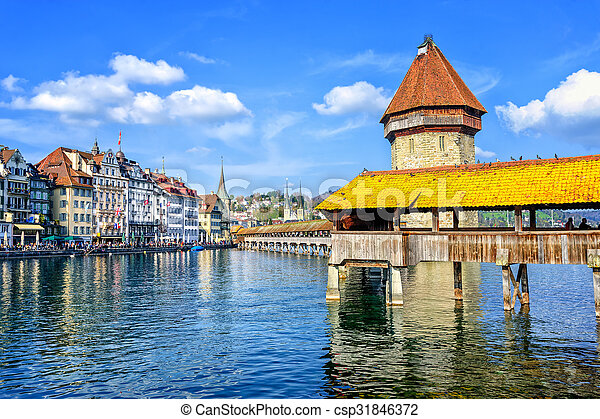 Lucerne, Switzerland, cityscape with wooden Chapel bridge and Water tower - csp31846372