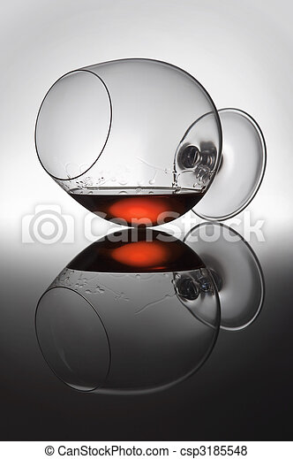 Play of light and colours in a glass with alcohol - csp3185548