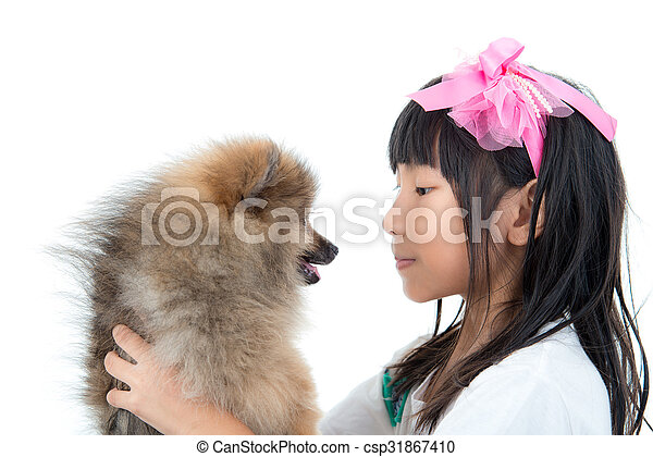 Cute Asian child with her happy doggy - csp31867410