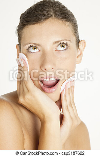 portrait of young woman with cotton pads