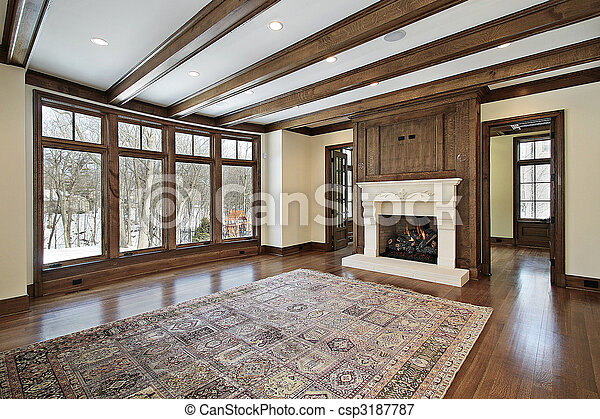 Family room with wood ceiling beams - csp3187787