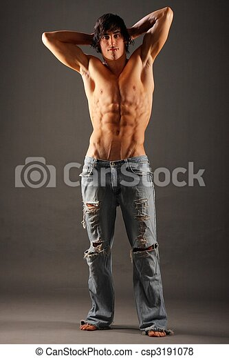 Young very muscular half-naked male standing - csp3191078