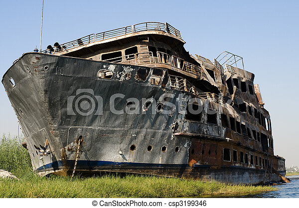 Burned derelict cruise boat on the Nile. - csp3199346