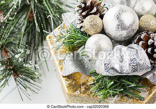 Christmas gift box under Christmas tree.