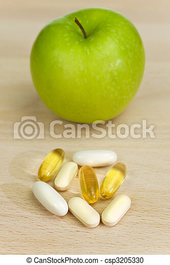 Green Apple and Nutrition Supplement Tablets or Medicine - csp3205330