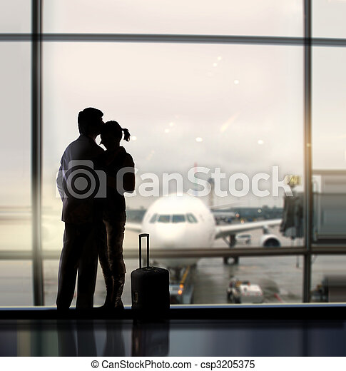 sweethearts in airport - csp3205375