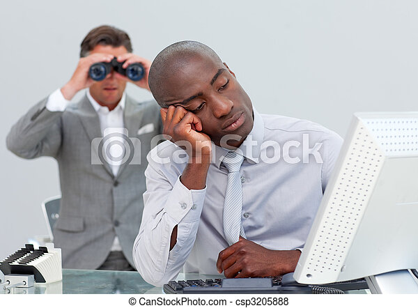 Unhappy businessman getting bored and his manager looking through binoculars in the office - csp3205888