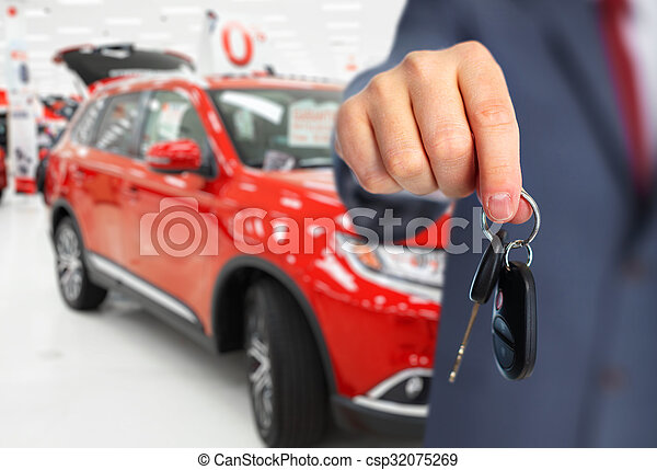 Car dealer hand with a key.