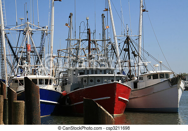 Three fishing trawlers tied to the moor at days end - csp3211698