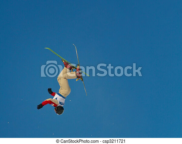 freestyle skier performing an aerial jump on a clear and sunny day - csp3211721