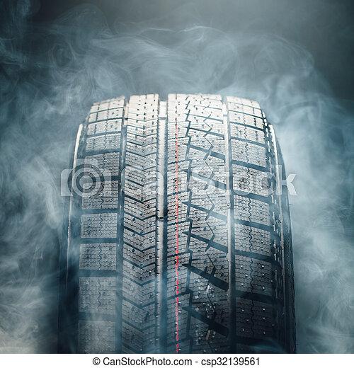 winter tire in smoke, closeup view