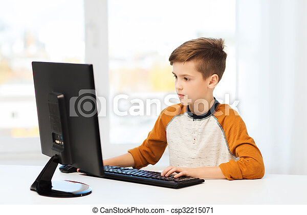 boy with computer at home - csp32215071