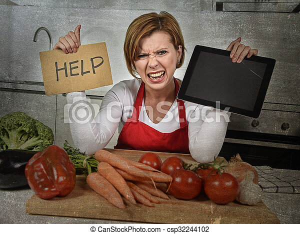 inexperienced home cook woman in red apron screaming desperate and frustrated at domestic kitchen in stress
