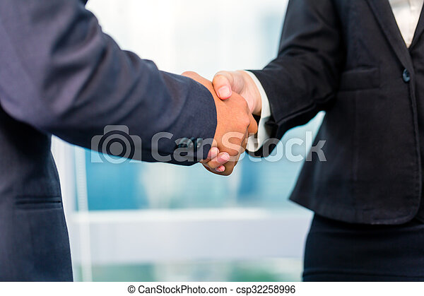 business people shaking hands - csp32258996