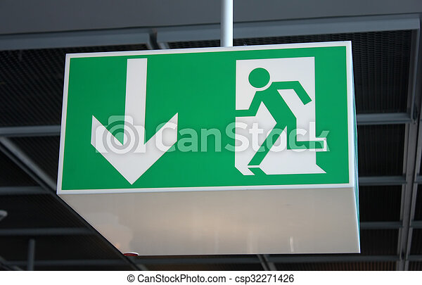 green exit sign attached to the ceiling