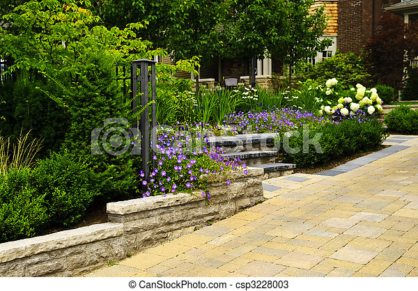Landscaped  garden and stone paved driveway - csp3228003