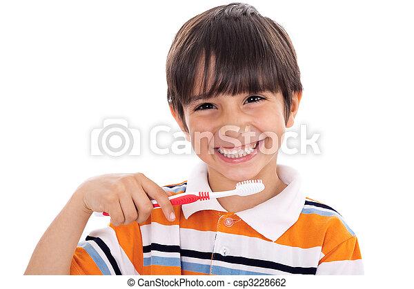 Closeup of cute kid brushing his teeth - csp3228662