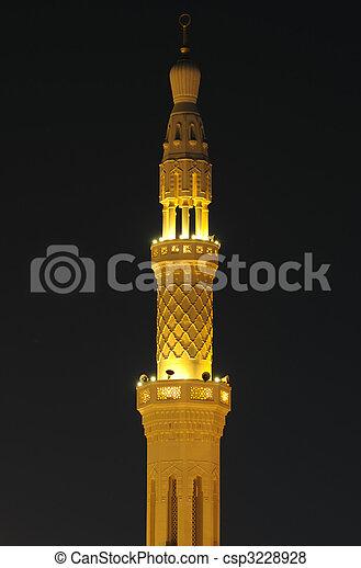 Mosque Minaret illuminated at night. Dubai, United Arab Emirates
