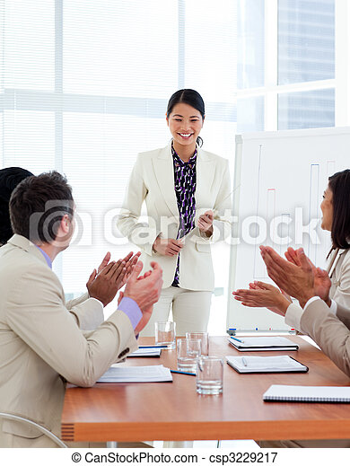 Successful asian woman giving a presentation - csp3229217