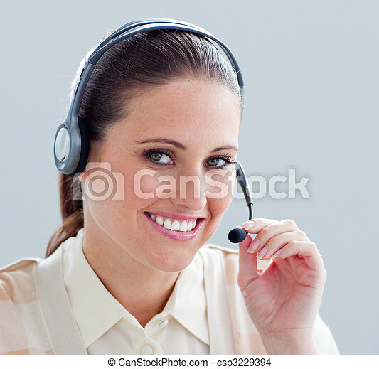 Close-up of a businesswoman with headset on - csp3229394