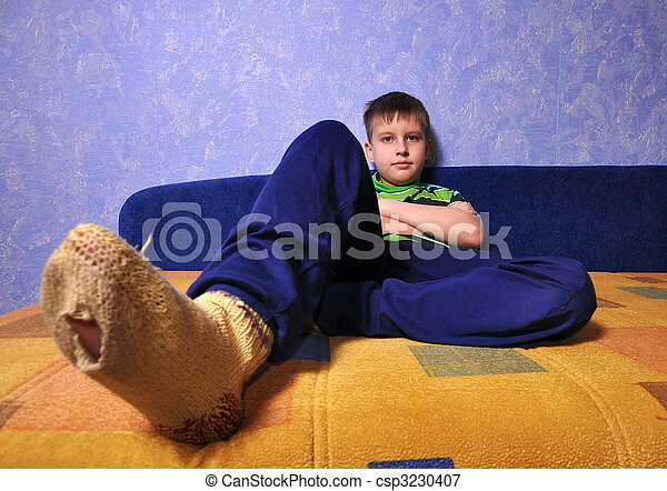 Boy wearing  socks with holes in them  - csp3230407
