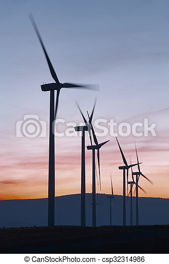 Wind mill farm at dusk. Global warming. Sustainable energy. Power