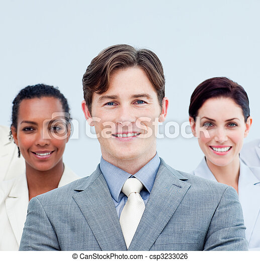 Smiling business people standing with folded arms  - csp3233026