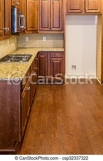 New Kitchen with Dark Cabinets and Granite Countertop - csp32337322