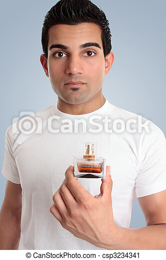 A man holds a bottle of cologne - csp3234341