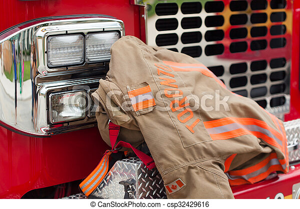 Close-up of rescue protective suit on bumper of fire vehicle
