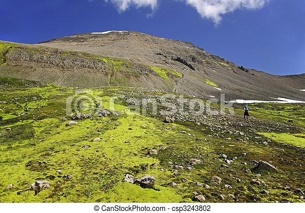 Hiker climbing an unspoiled mountain side - csp3243802