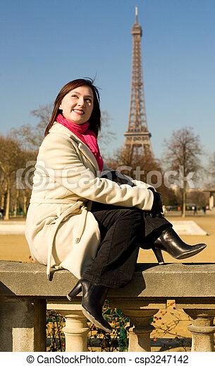 Happy beautiful woman in Paris near the Eiffel Tower, having fun