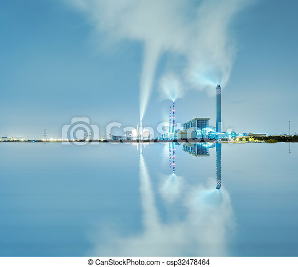 Smoking pipes of thermal power plant against blue sky - csp32478464