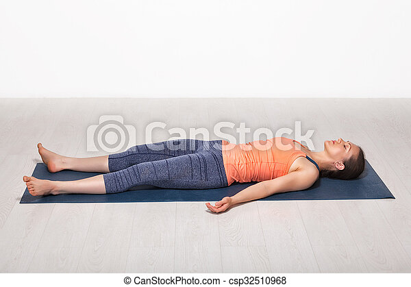 stock image of sporty fit girl relaxes in yoga asana