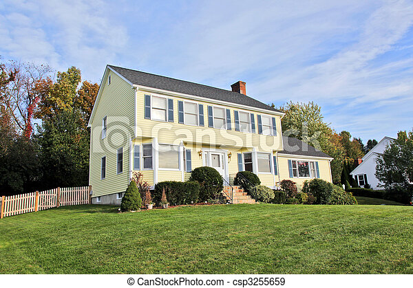 Yellow New England Style colonial house - csp3255659