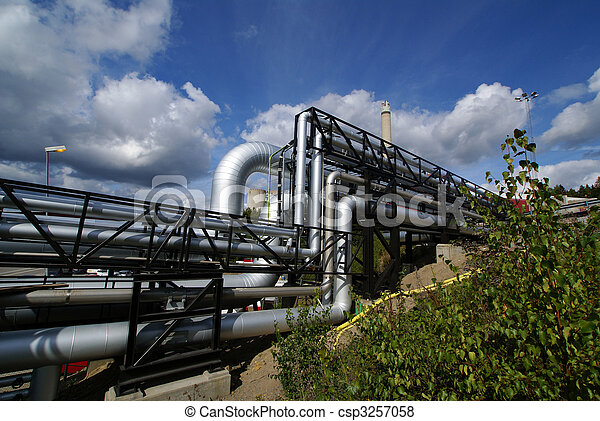 industrial pipelines on pipe-bridge against blue sky - csp3257058