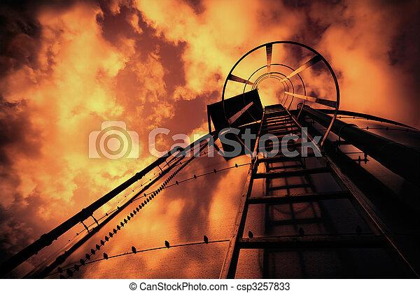 Refinery ladder under evil sky - csp3257833